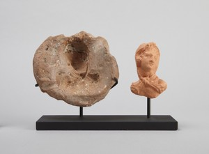 Mold for a head of Herakles (with modern plaster cast on same stand